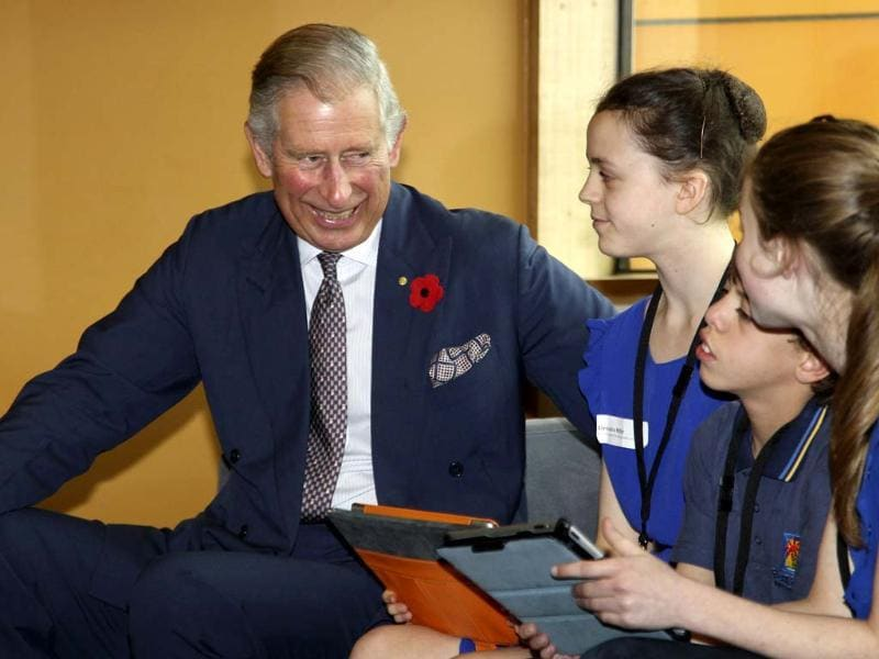 Britain's prince Charles shares a light moment with students at the Victorian College of the Arts Secondary School in Melbourne. REUTERS/Brandon Malone