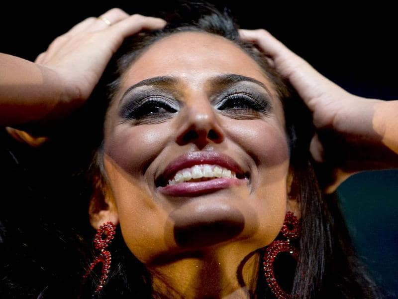Representative of Argentina's Tucuman province Camila Solorzano, reacts after being chosen as Miss Argentina and represent the country in the 2012 Miss Universe contest on December 19th in Las Vegas, in Buenos Aires, Argentina. (AP Photo/Natacha Pisarenko)