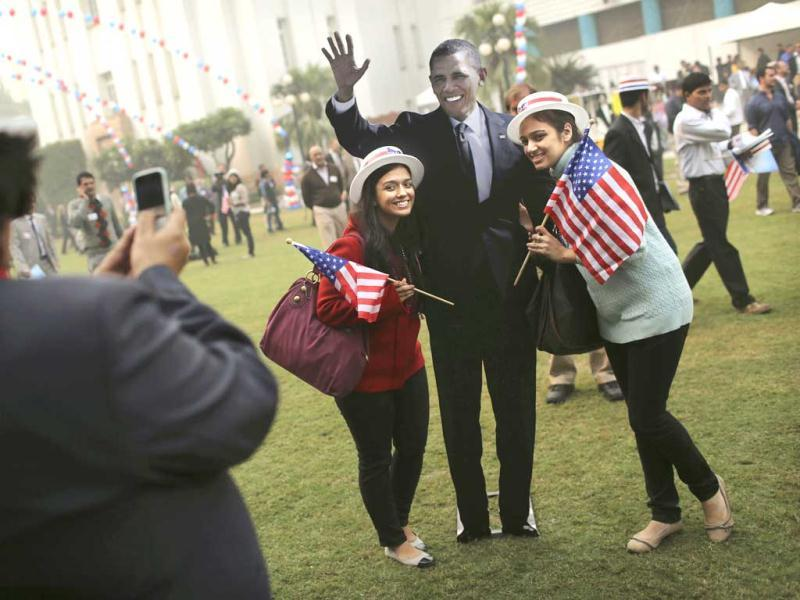Students have their picture taken next to a cardboard cutout of President Barack Obama after he was projected as the winner of the US presidential election during an event organized by the US Embassy at the landmark Imperial Hotel in New Delhi. AP Photo/Kevin Frayer