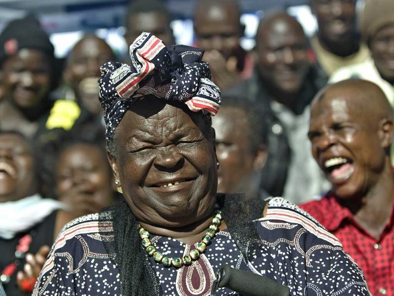 Sarah Obama, step-grandmother to USA's President elect, Barak Obama, reacts with members of her family the hamlet of Kogelo in western Kenya during a press conference that followed media-anouncements of Obama's apparent victory. AFP Photo/Tony Karumba