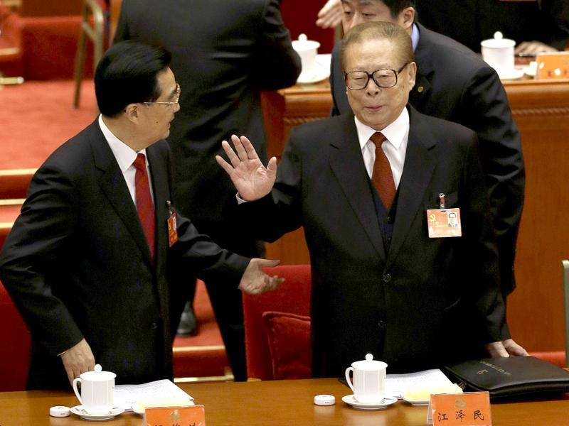 Former Chinese President Jiang Zemin gestures at Chinese President Hu Jintao, left, during the opening session of the 18th Communist Party Congress held at the Great Hall of the People in Beijing. (AP Photo/Ng Han Guan)