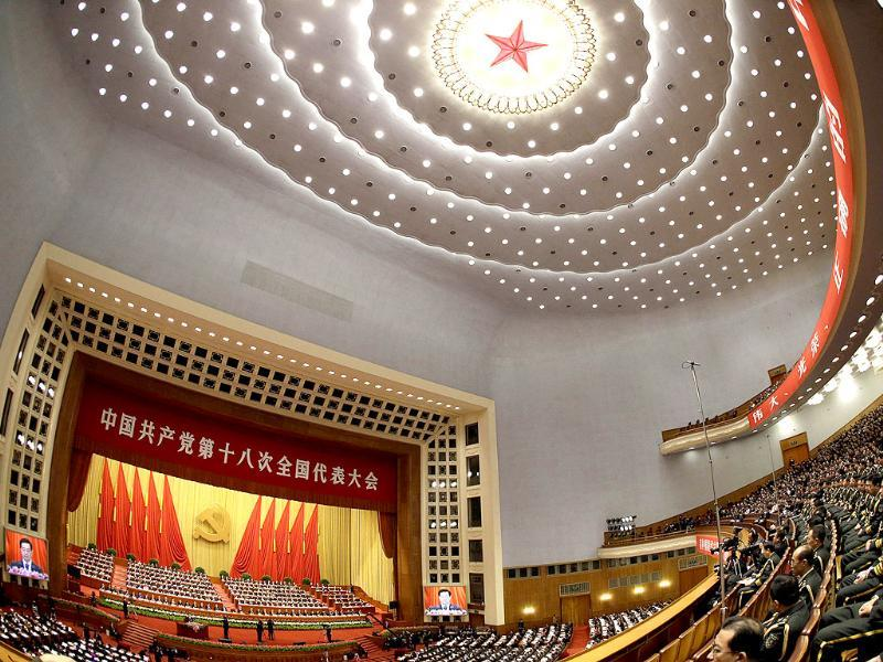 Chinese President Hu Jintao, at left, addresses the opening session of the 18th Communist Party Congress held at the Great Hall of the People in Beijing. (AP Photo/Ng Han Guan)