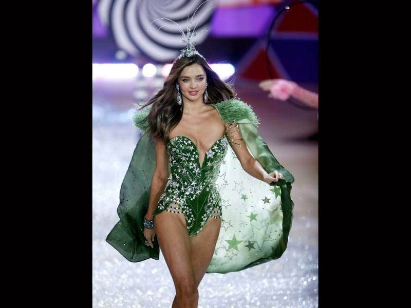 Miranda Kerr leaves little to imagination in her star-spangled green outfit.