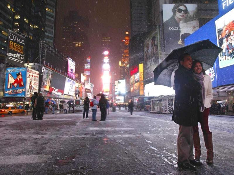 A couple have the picture taken during a snow storm in New York's Times Square. Reuters/Brendan McDermid