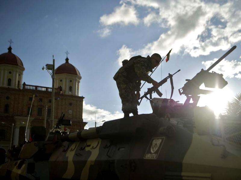 A Colombian soldier stands on a war tank in Santa Rosa de Osos municipality, Antioquia department, Colombia. (AFP Photo)