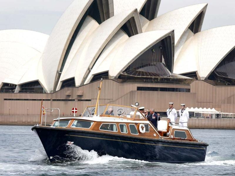 Britain's Prince Charles travels on the Admiral's Barge past the Sydney Opera House as he crosses Sydney Harbour in Sydney. (AFP Photo)