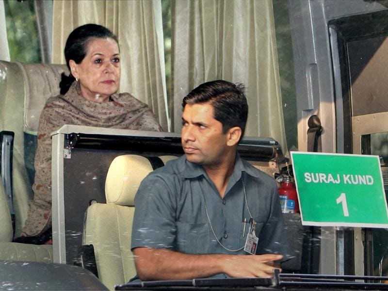 Congress President Sonia Gandhi sits inside a bus at AICC headquarters to leave for Surajkund to attend the party's 'Samvad Baithak'. PTI Photo by Kamal Singh