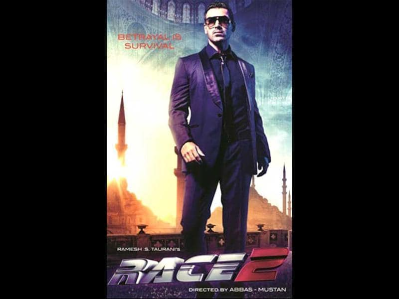 John Abraham looks super hot in a black tuxedo in Race 2 poster. A pair of sunglasses complements his look.