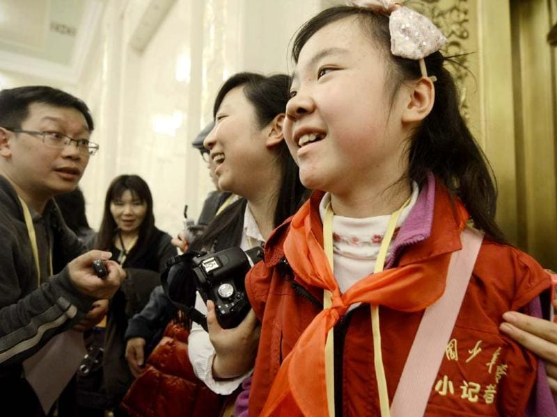 This picture shows Sun Luyuan, a Beijing sixth-grade student being interviewed at the Great Hall of the People during the 18th National Congress of the Communist Party of China in Beijing. AFP photo
