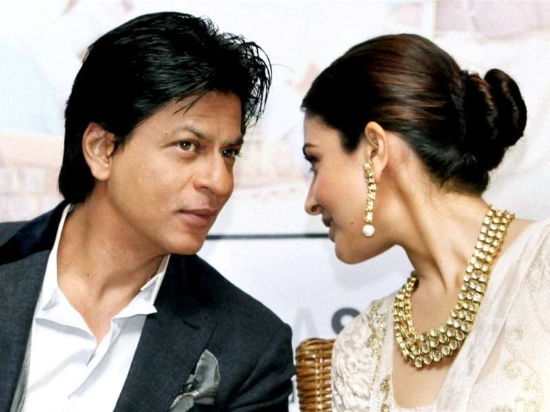 What's cooking? Anushka Sharma whispers into Shah Rukh Khan's ear during the event. (PTI Photo)