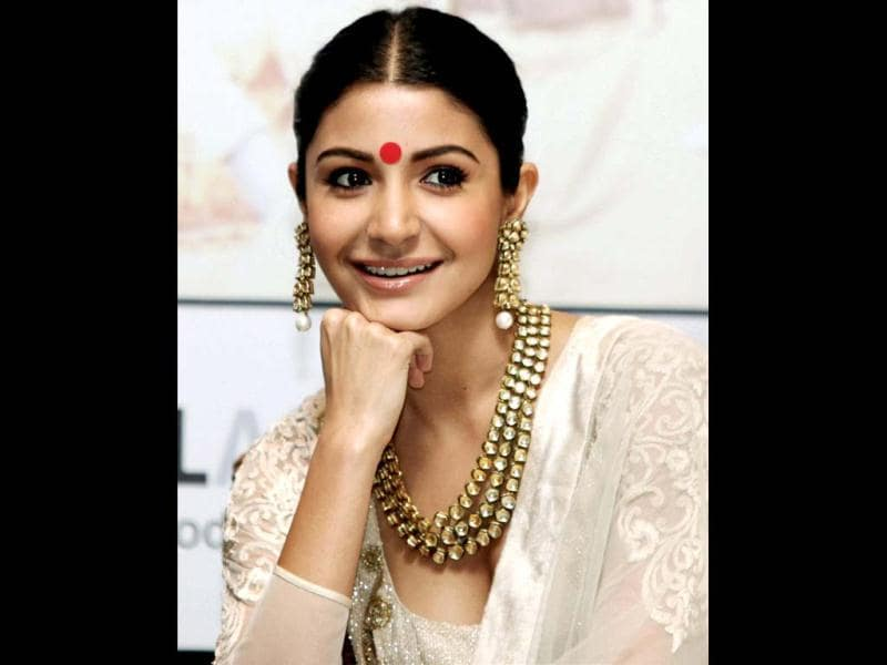 Anushka Sharma looks like a Bengali beauty! The actress stuns in an Anarkali suit teamed up with a big red bindi. (PTI Photo)
