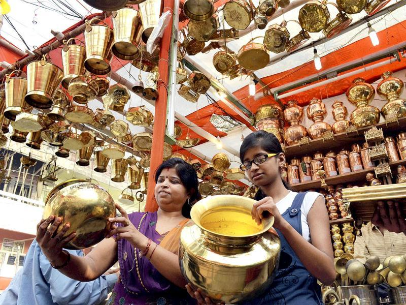 Women buy metal goods at a shop on the occasion of Dhanteras in Patna. PTI