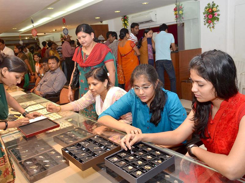 Women buy jewelry at a shop on the occasion of Dhanteras in Patna. Agencies