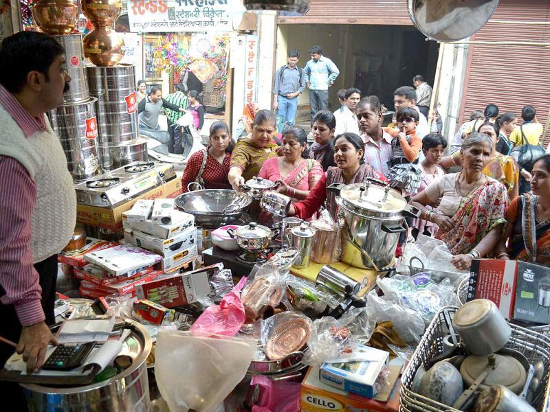 Women buying utensils on the occasion of 'Dhanteras' festival in Mathura. Agencies