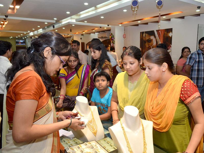 Women buying jewelery at a shop on the occasion of 'Dhanteras' in Patna. Agencies