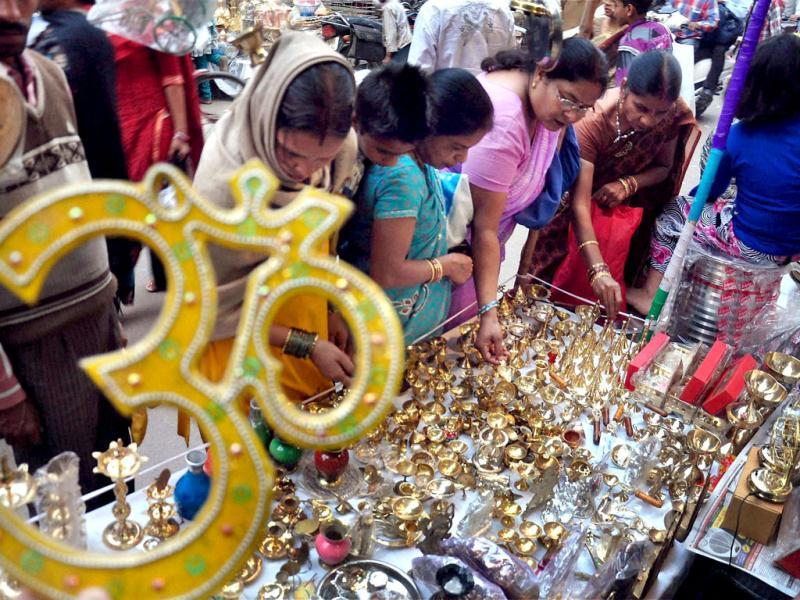 Women buy utensils on the occassion of Dhanteras at a market in Moradabad. PTI