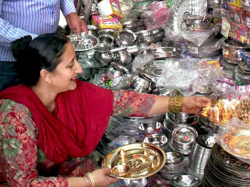 People purchase utensils on the occassion of Dhanteras in Jammu. PTI