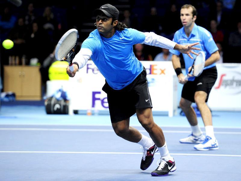Leander Paes returns as Radek Stepanek covers during their defeat at the hands of Mahesh Bhupathi and Rohan Bopanna in their semi-final doubles match on the seventh day of the ATP World Tour Finals tennis tournament in London. AFP/Glyn Kirk