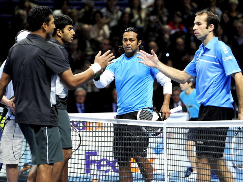 Mahesh Bhupathi and Rohan Bopanna shake hands at the net with Leander Paes and Radek Stepanek after Bhupathi and Bopanna won their semi-final doubles match on the seventh day of the ATP World Tour Finals tennis tournament in London. AFP/Glyn Kirk