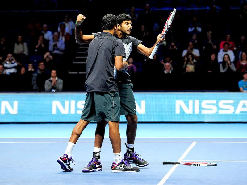Mahesh Bhupathi and Rohan Bopanna celebrate their victory over Leander Paes and Radek Stepanek during their semi-final doubles match on the seventh day of the ATP World Tour Finals tennis tournament in London. AFP/Glyn Kirk