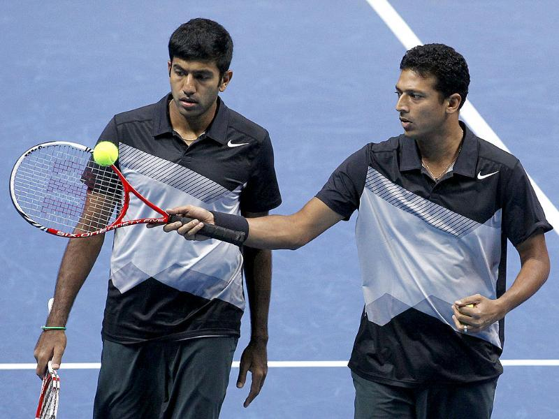 Mahesh Bhupathi talks to his partner Rohan Bopanna during their ATP World Tour Finals doubles semifinal tennis match against Leander Paes and Radek Stepanek at the O2 Arena in London. AP/Sang Tan