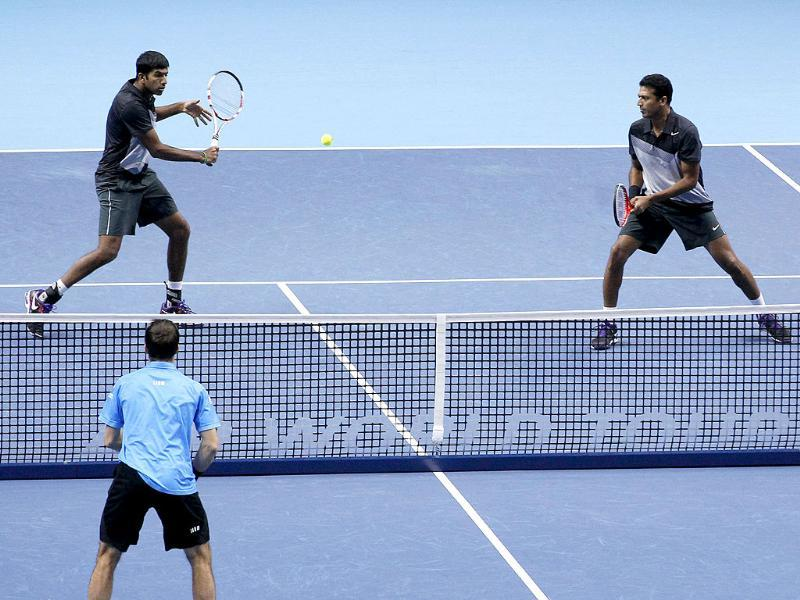 Rohan Bopanna and Mahesh Bhupathi play a return to Leander Paes and Radek Stepanek during their ATP World Tour Finals doubles semifinal tennis match at the O2 Arena in London. AP/Sang Tan
