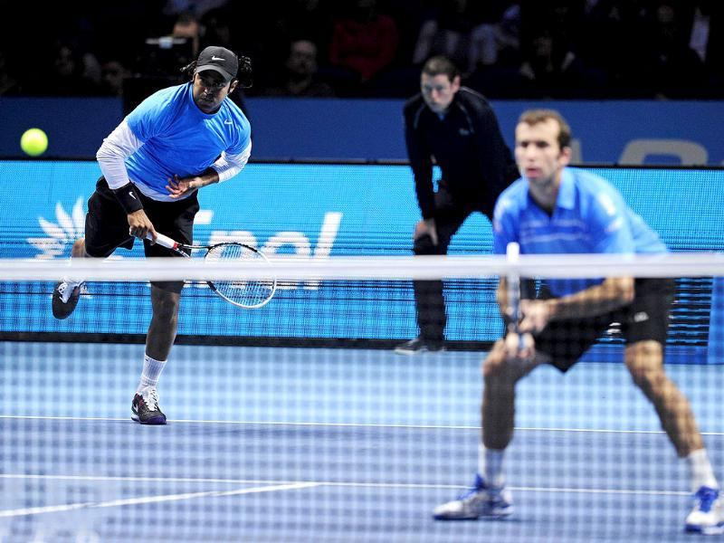 Leander Paes serves as his partner Radek Stepanek covers the net against Mahesh Bhupathi and Rohan Bopanna during their semi-final doubles match on the seventh day of the ATP World Tour Finals tennis tournament in London. AFP/Glyn Kirk