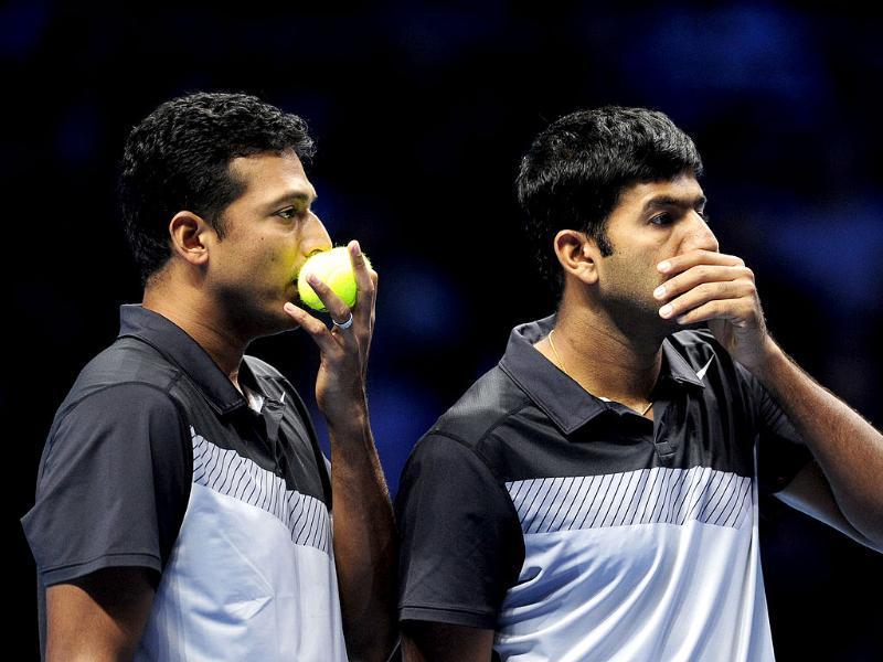 Mahesh Bhupathi and Rohan Bopanna talk between points against Leander Paes and Radek Stepanek during their semi-final doubles match on the seventh day of the ATP World Tour Finals tennis tournament in London. AFP/Glyn Kirk