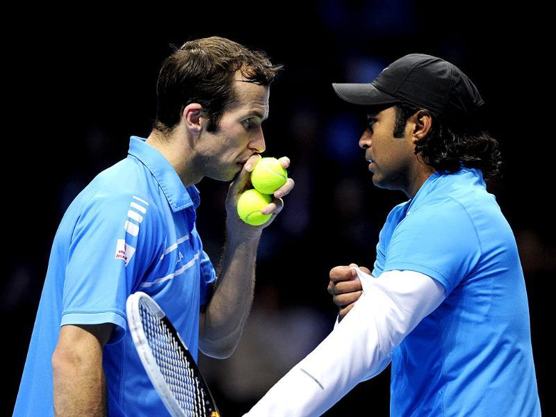 Leander Paes and Radek Stepanek talk between points against Mahesh Bhupathi and Rohan Bopanna during their semi-final doubles match on the seventh day of the ATP World Tour Finals tennis tournament in London. AFP/Glyn Kirk