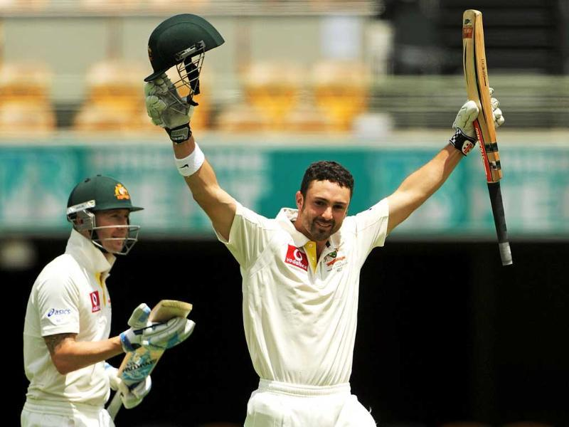 Australian cricketer Ed Cowan raises his arms alongside captain Michael Clarke after reching his 100 on day four of the first cricket Test between South Africa and Australia at the Gabba ground in Brisbane. AFP photo