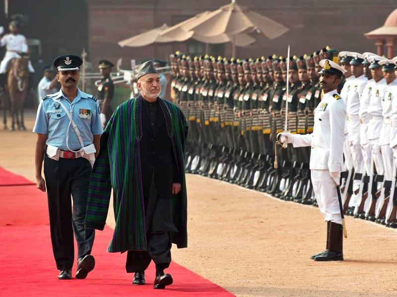 Afghanistan President Hamid Karzai inspects a guard of honor during a ceremonial reception at Presidential palace in New Delhi. AFP photo