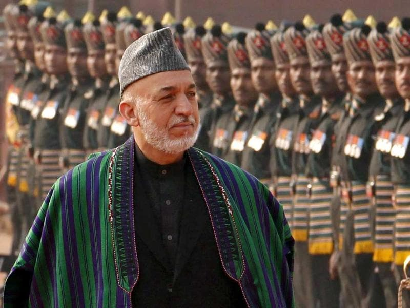 Afghanistan's President Hamid Karzai inspects the guard of honour during his ceremonial reception at the forecourt of Rashtrapati Bhavan in New Delhi. Reuters