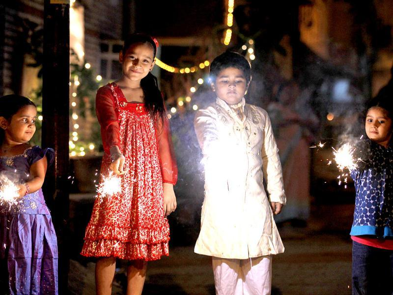 Children play with crackers on the eve of Diwali in New Delhi. HT/Raj K Raj
