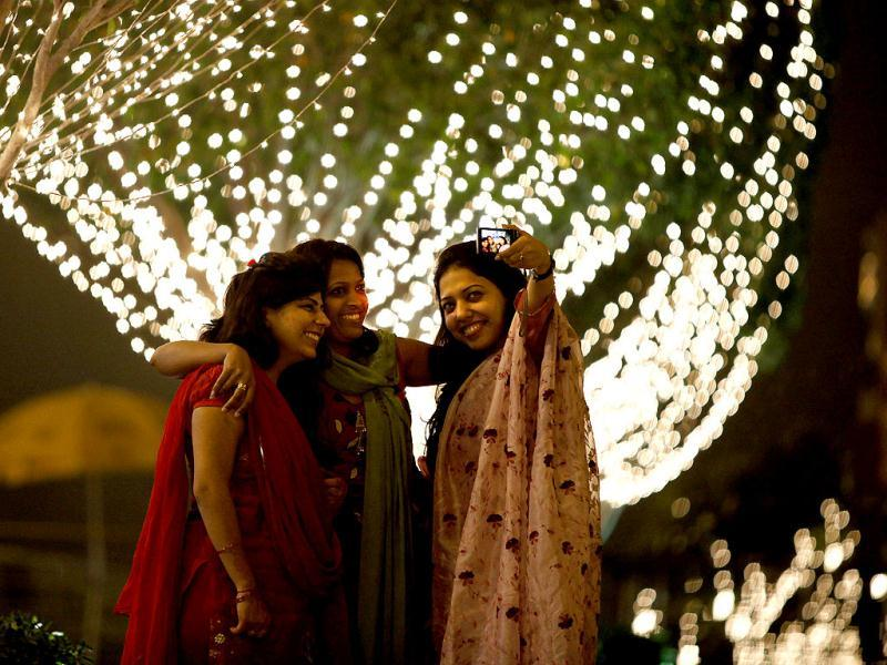 Friends have a good time at a mall on the eve Diwali, in New Delhi. HT/M Zhazo