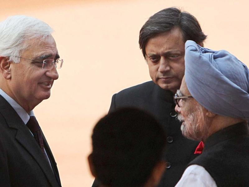 Prime Minister Manmohan Singh, external affairs minister Salman Khurshid and MoS for HRD Shashi Tharoor during a ceremonial reception for Afghan President Hamid Karzai at the forecourt of the Rashtrapati Bhavan in New Delhi. (PTI Photo)