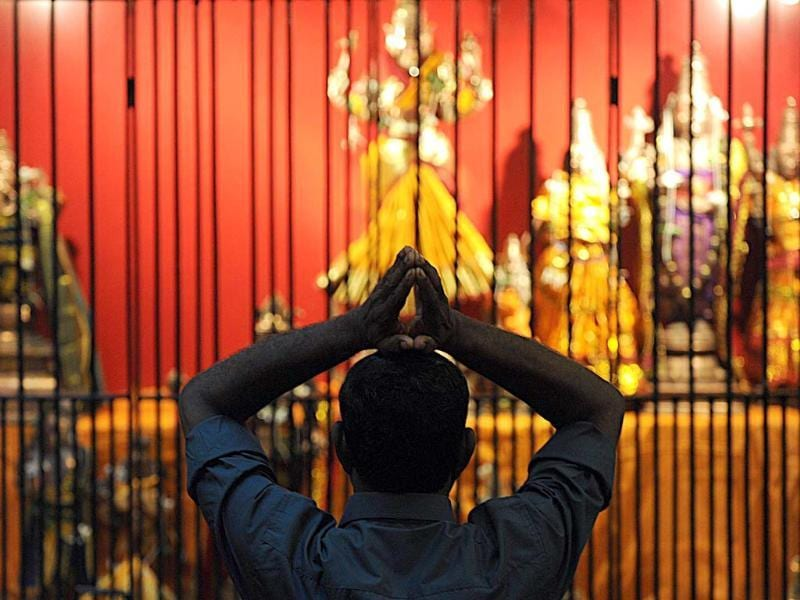 A Sri Lankan Hindu offers prayers during Diwali at a Hindu temple in Colombo. AFP PHOTO