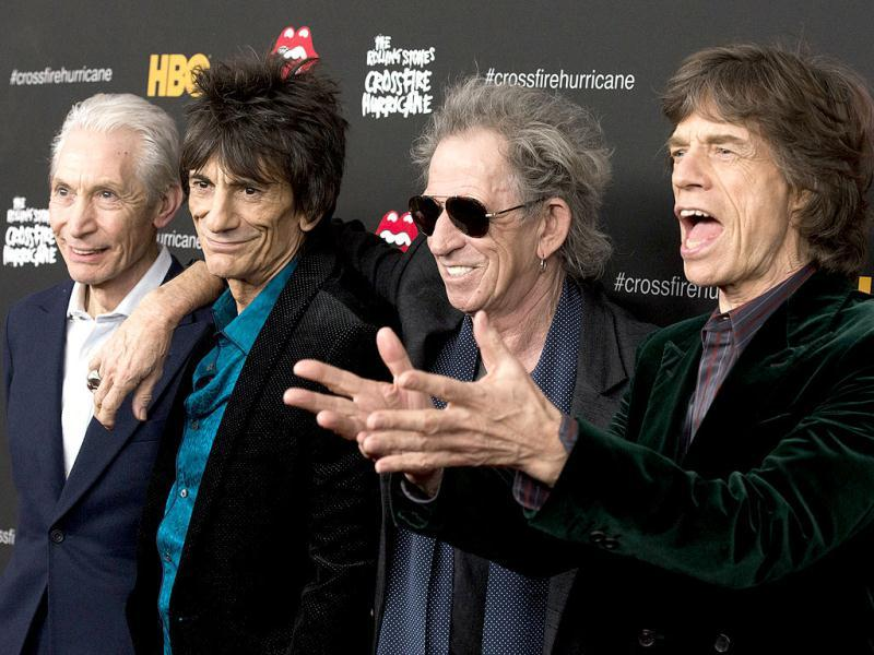 Rolling Stones band members, from left, Charlie Watts, Ronnie Wood, Keith Richards and Mick Jagger attend