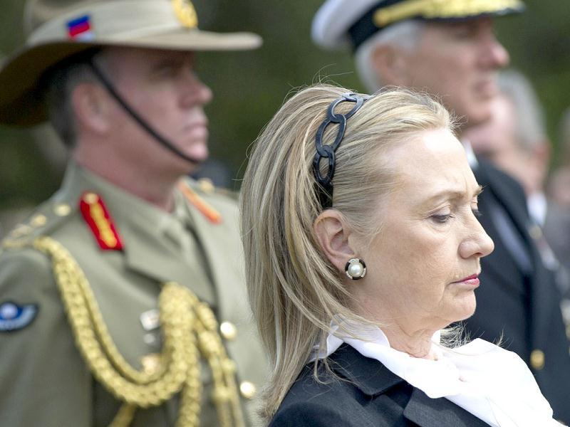 U.S. Secretary of State Hillary Clinton looks on during the playing of Taps after participating in a wreath laying ceremony at the State War Memorial, prior to meetings as part of AUSMIN, in Kings Park. (Reuters)