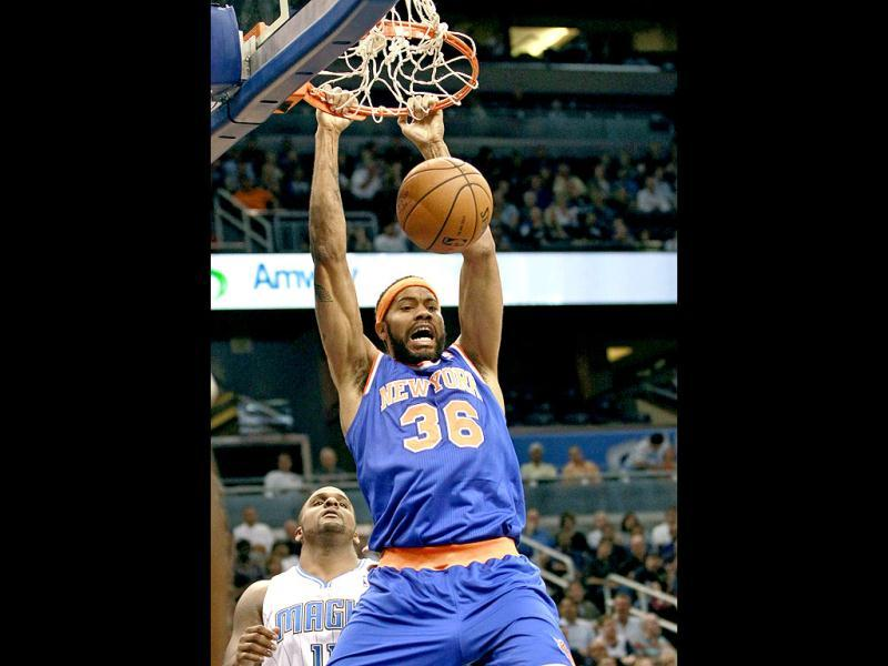 New York Knicks' Rasheed Wallace (36) dunks the ball in front of Orlando Magic's Glen Davis, left, during the first half of an NBA basketball game. (AP Photo)