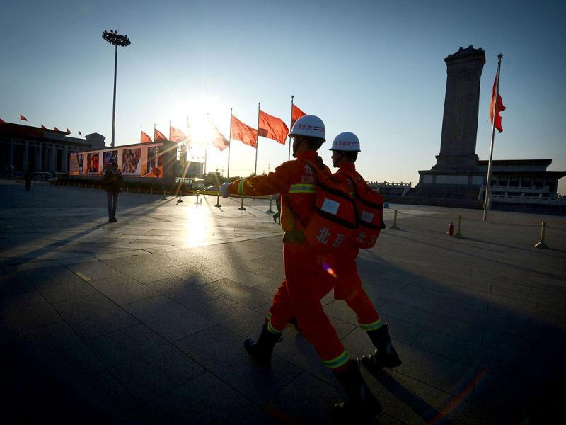 Fire officers patrol Tiananmen Square before the closing ceremony of the Party Congress at the Great Hall of the People in Beijing. China's Communist Party will on November 15 unveil the new set of top leaders who will run the country for the next decade, one day after its week-long congress ends. (AFP Photo)