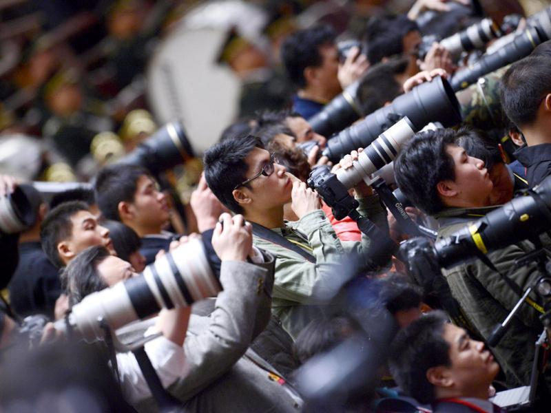 Photographers take photos during the closing of the 18th Communist Party Congress at the Great Hall of the People in Beijing. The week-long Communist Party Congress will end with a transition of power to Chinese Vice President Xi Jinping, who will govern for the coming decade amid growing pressure for reform of the communist regime's iron-clad grip on power. (AFP Photo)