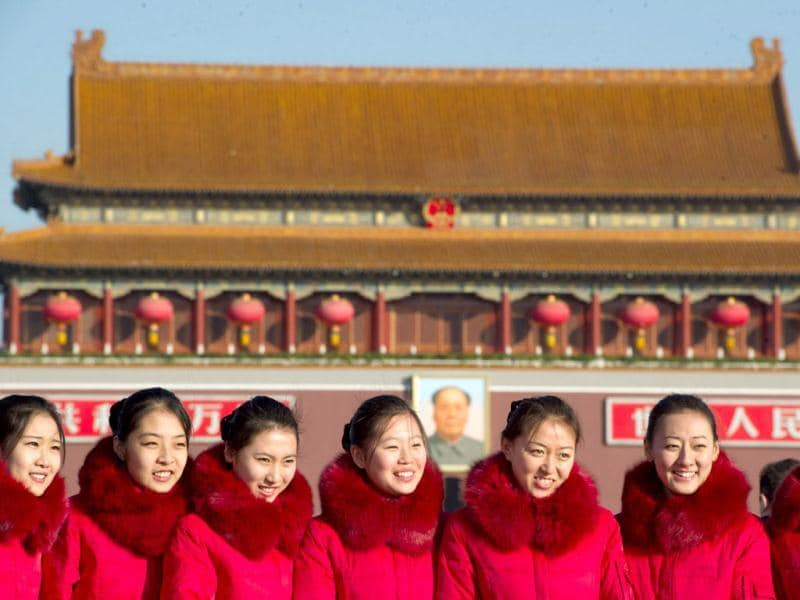 Hostesses pose before Tiananmen gate on Tiananmen Square as delegates arrive at the Great Hall of the People for the start of the closing ceremony of the Communist Party Congress in Beijing. The week-long Communist Party Congress will end with a transition of power to Vice President Xi Jinping, who will govern for the coming decade amid growing pressure for reform of the communist regime's iron-clad grip on power. (AFP Photo)