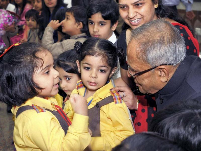 President Pranab Mukherjee interacts with children from various school to accept wishes on the occasion of Children's Day at Rashtrapati Bhavan in New Delhi. PTI photo