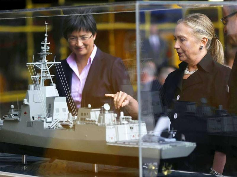 US Secretary of State Hillary Clinton (R) and Australian finance minister Penny Wong view a model during a tour of the Techport Australia shipbuilding facility near Adelaide. Reuters photo