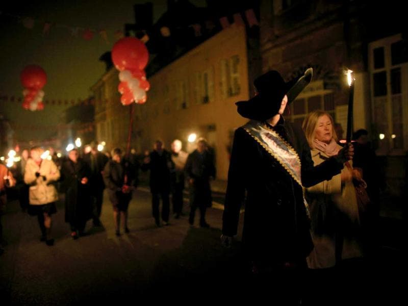 People celebrate in Beaujeu streets the traditional event of
