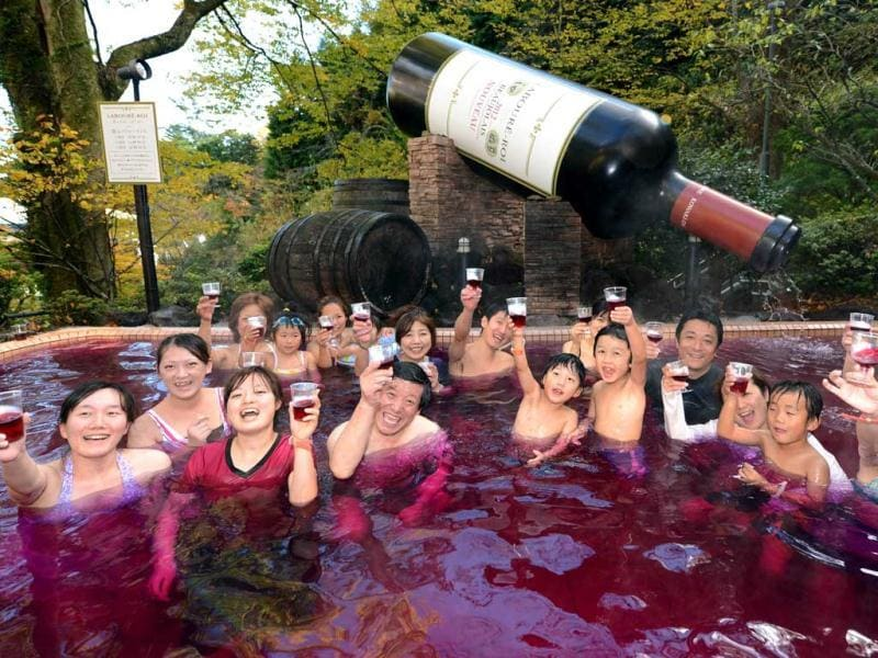 Visitors toast 2012 Beaujolais Nouveau wine while enjoying the wine spa at the Hakone Yunessun spa resort facilities as the new vintage Beaujolais Nouveau is officially uncorked. (AFP Photo)