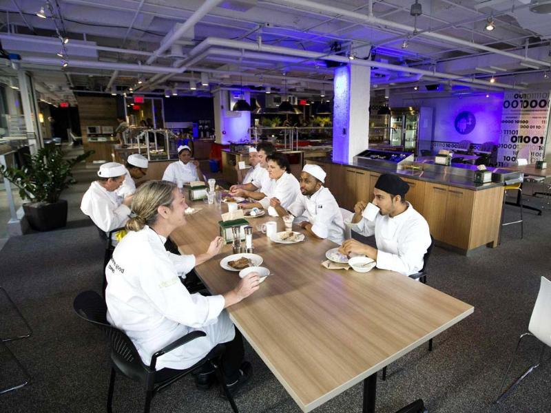 The food preparation team sit down to eat at the new Google office in Toronto, November 13, 2012. Google employees have prepared meals made for them free of charge everyday. Reuters/Mark Blinch