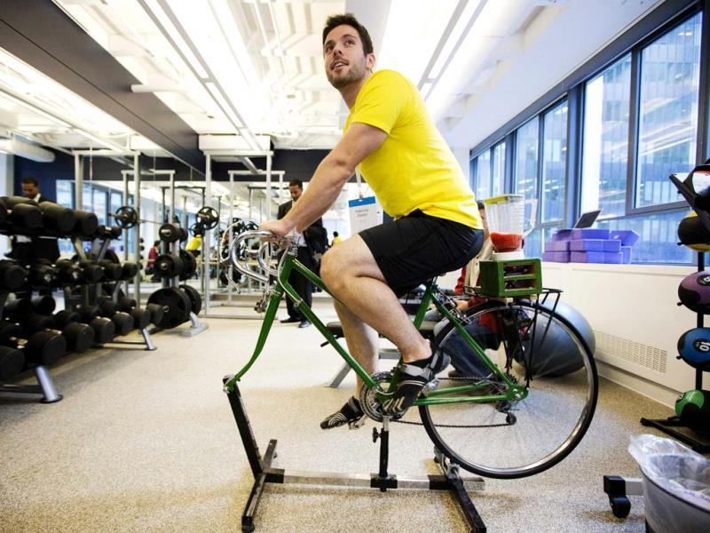 An employee demonstrates the use of an exercise cycle, that powers a blender making a fruit smoothie, inside the employee gym at the new Google office in Toronto, November 13, 2012. Reuters/Mark Blinch