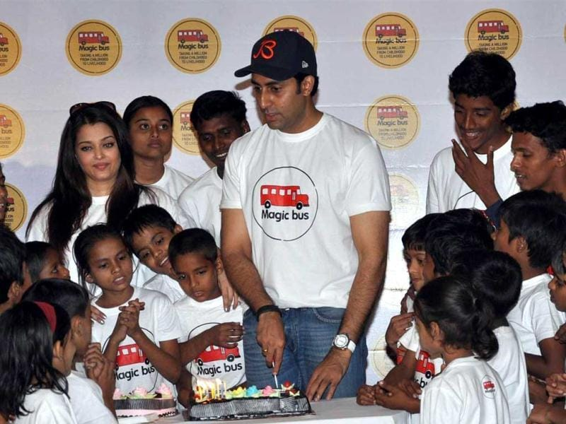 Abhishek Bachchan cuts the cake with the excited kids of Magic Bus NGO.