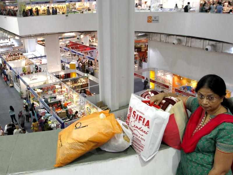 A top view of Hall No 18 as a woman visitor seen waiting at India International Trade Fair at Pragati Maidan in New Delhi. Hindustan Times